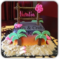 Hawaiian Theme Cake Fondant Covered Cake Airbrushed Sunset With Fondant Tiki Sign Fondant Palm Trees And Brown Sugar Sand Hawaiian theme cake. Fondant covered cake airbrushed sunset with fondant tiki sign. Fondant palm trees and brown sugar sand.
