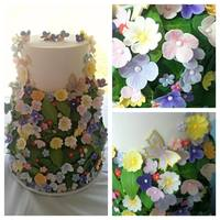 Summer Garden Wedding Cake   *Three tier wedding cake, covered in fondant, gum paste leaves, and gum paste flowers