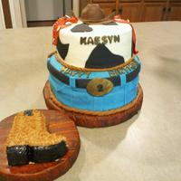 Western Cake  Boy's 2nd birthday cake and boot smash cake. The blue jeans are fondant, cow hide is buttercream with fondant, the board is covered...