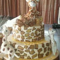 Giraffe Themed Baby Shower Cake  *Made this cake for a giraffe themed baby shower. All buttercream icing with leather chocolate spots painted with gold dust. The giraffes...