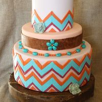 New Mexico Wedding Cake New Mexico wedding cake. Desert colored chevrons, and gumpaste turquoise.