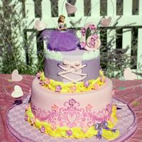 Rapunzel Birthday Cake Rapunzel Birthday Cake! Stenciled bottom tier, the top I laced to look like a corset and added a layer of lace. And braided glittered...