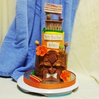 2 Tier Yellow Cake With Mini Chips In A Hawaiian Tiki And Cabana Theme In Buttercream Icing With Fondant Accents 2 tier yellow cake with mini chips in a Hawaiian tiki and cabana theme in buttercream icing with fondant accents
