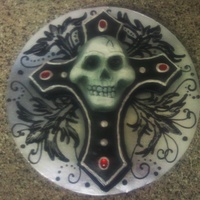 Raspberry Velvet Cake With Buttercream Icing Airbrushing And Acrylic Jewels In A Gothic Cross And Skull Theme With Black Filigree Piping On... Raspberry velvet cake with buttercream icing, airbrushing and acrylic jewels in a gothic cross and skull theme with black filigree piping...