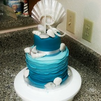 Sea Shell Wedding Cake With Fondant Shells And An Ombre Reverse Ruffle Sea shell wedding cake with fondant shells and an ombre reverse ruffle