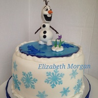 Olaf Birthday Cake Olaf finds a flower. Olaf is made from modeling chocolate and covered in fondant. He is sitting on ice made from sugar. Snowflakes are...
