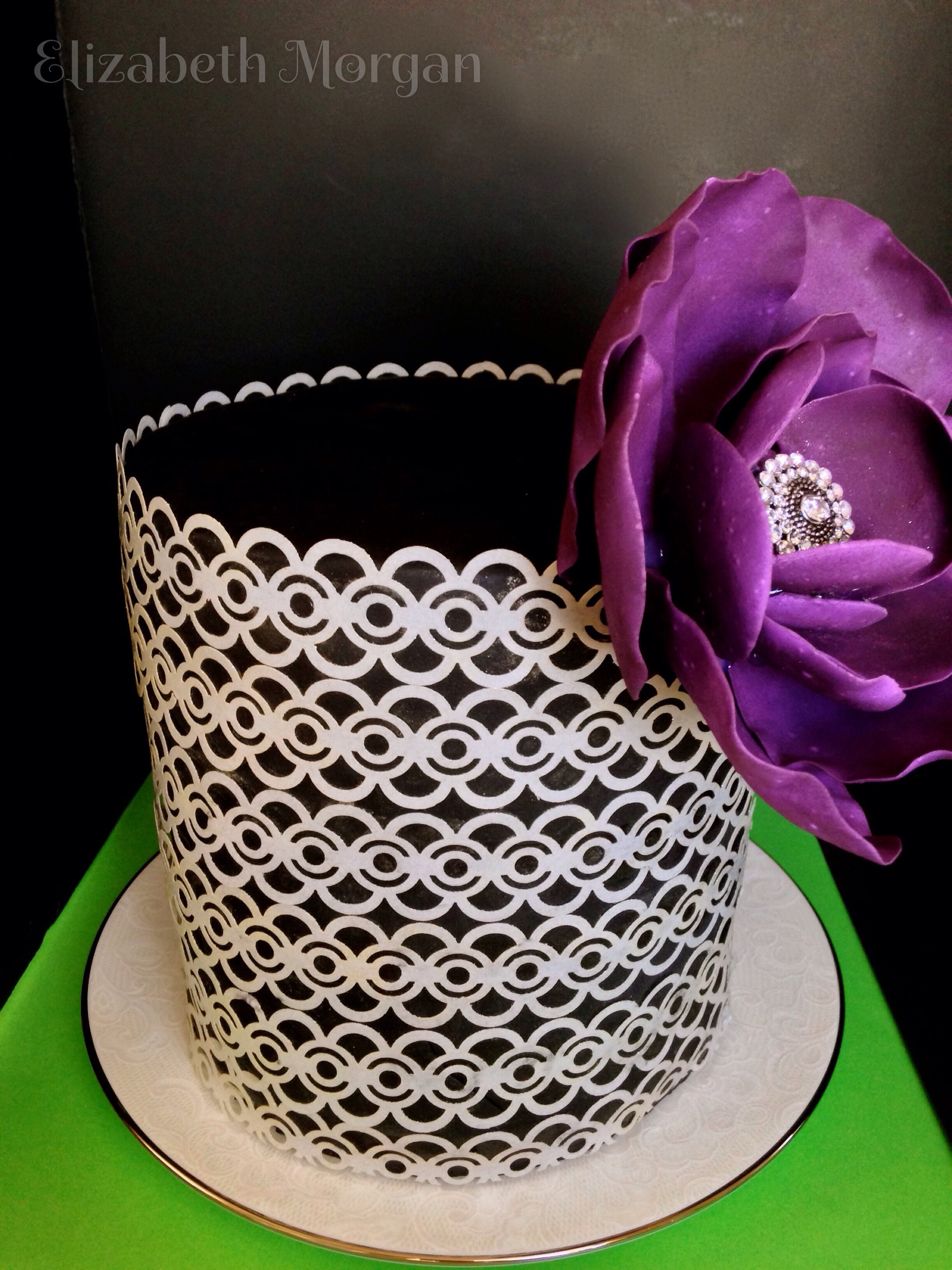 Wafer Paper Cake Wafer paper covered cake with a 50/50 fondant gumpaste flower.