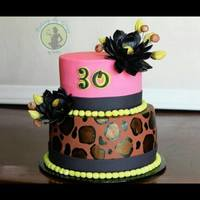 Leopard And Pink Cake * fondant covered cake with hand painted leopard print and handmade fondant lotus and buds
