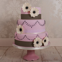 Anemone Chic A 3 tier dusky pink wedding cake complimented by hand made sugar anemones and black piped pearls