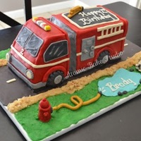 3D Firetruck  Firetruck cake for my son. This was my first 3D/sculpted cake. It was also my first time using modeling chocolate. All decorations with the...