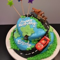 Cars (Disney/pixar) Cake Disney/Pixar Cars cake for my son. This was my very first fondant cake. The cars are matchbox cars (not edible). Fondant decorations with...