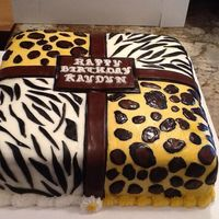 "Animal Print Cake Leopard & Zebra print fondant on buttercream icing over a WASC cake with pineapple filling, 12"" square' 2 2"" layers."