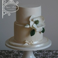 Elegant Magnolia.   Simple and clean sugar Magnolia engagement cake. Elegant stripes on first tier to add more details.