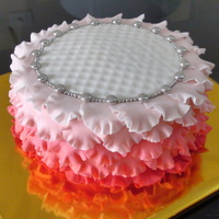 Rose Petal Ruffle Cake!!  The ruffles r done in a gradual transition from a Bright Red to a very Pale Pink.Edible Silver jewels r added 2 make the recipient feel...