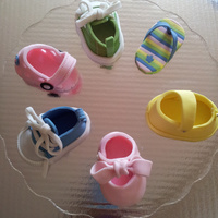 Fondant Shoes Variety of baby fondant shoes including a havaiana.