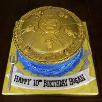 Percy Jackson Cake The Top Is Completely Edible Made From Cake Fondant Royal Icing And Airbrushed With Gold Percy Jackson cake. The top is completely edible, made from cake, fondant, royal icing and airbrushed with gold.