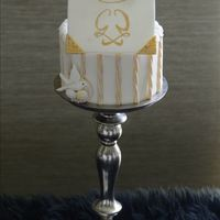 Grace Kelly Inspired Cake   Cake with white sugar carnations, doves and handpainted Grace Kelly monogram on fondant.