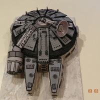 "Millenium Falcon Ship Cake Bottom Base Is A 12 Cake Top Of Ship Is Domed Rice Krispies With Fondant Cut Out Details Dried Placed And Decor... Millenium Falcon ship Cake Bottom base is a 12"" cakeTop of ship is domed rice krispies with fondant cut out details dried, placed and..."