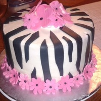 Zebra Stripe Birthday Cake 8inch double stacked vanilla buttercream cake with fondant zebra stripes and flowers.