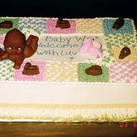 Baby On A Quilt With Chocolate Toys Baby on a quilt with chocolate toys