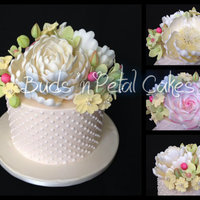 Trio Of Roses Rose, open peony and closed peony with pastel filler flowers on ivory with white piped dots.