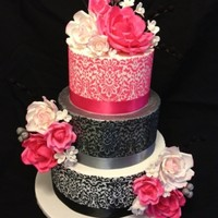 Floral Shimmer Pretty 3 tier wedding cake with stencilling, silver shimmer on middle tier and gum paste roses.