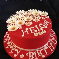 Daisies Chocolate cake with chocolate ganache and, as requested, white daisies on a red cake. Birthday girls favourite colours.