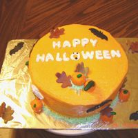 Fall Cake   Sprayed cake with Wilton Color Mist, Fondant Leaves, pumpkins and bats.