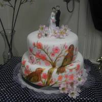 Hand Painted Cherry Blossom Two Tier Cake The Bride And Groom Where Young The Cake Is A Confetti Cake Icing Is Fondant *Hand painted cherry blossom two tier cake. The bride and groom where young, The cake is a confetti cake :) Icing is fondant.