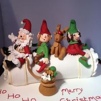 Santa And His Helpers On A Christmas Cake Cracker Santa and his helpers on a Christmas cake cracker