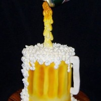 Pouring Beer Cake Made for a friends birthday, he loved it! was a lot of fun to make. Thanks for looking!