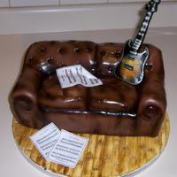 Rocker Cake,couch, Music,guitar so I was inspired by art2eat cake, love her work, so I tried my had at a rocker couch cake. chocolate fondant, edible image music sheets...