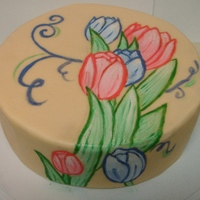 Painted Tulip Cake First attempt at a hand painted cake (based on the Craftsy class). I wanted to tie a ribbon around the base to finish it, but didn't...
