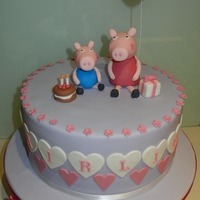 Peppa Pig Cake Everything is hand made and edible apart from the balloon wire! Loved making this cake and love Peppa Pig!