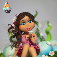 Spring Fairy Spring Fairy hand molded with sugar paste, was created for portuguese magazine. In this creation you can see Spring blossom throughout the...