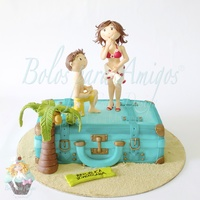 Will You Marry Me?... Vintage luggage was made with cake, covered with sugar paste and painted with edible dust. Figurines are hand moulded, also with sugar...