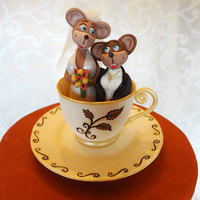 Mice In Tea Cup Gumpaste tea cup with mice couple cake topper. The mice were dressed to mimic the bride and groom's attire for an Alice in Wonderland...