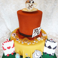 I Was Asked To Create An Alice In Wonderland Mad Hatter Tea Party Themed Wedding Cake In A Fall Color Palette Had Lots Of Fun Creating All... I was asked to create an Alice in Wonderland Mad Hatter tea party themed wedding cake in a fall color palette. Had lots of fun creating all...