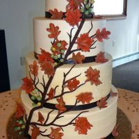 Fall Themed Wedding Cake Hi everyone.....I was asked to make my first-ever wedding cake! Wedding was fall themed/colored. Cake is WASC with chocolate mousse and...