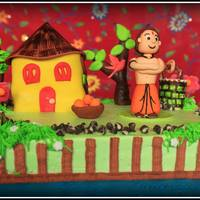 Chota Bheem In An Indian Village Setup A Redvelvet Cake With Whipped Cream Frosting And Fondant Figures Chota Bheem, in an Indian village setup...A RedVelvet cake with whipped cream frosting and fondant figures..