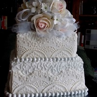 Wedding Roses Stephonitis Tulle And Sating Ribbon Topper Sides Of Cake Have Molded Lace Cornelli Lace And Chocolate Pearl Borders Thi Wedding roses, Stephonitis, tulle and sating ribbon topper. Sides of cake , have molded lace, Cornelli lace and chocolate pearl borders....