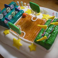 "Kids Basketball Court  Cake is a 2 layer "" 9 x 13 inch base covered in homemade Marshmallow Fondant. The court itself was made from a Duff plastic mold then..."