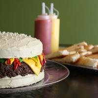 Cheeseburger And Angle Food Cake French Fries Along With Strawberry Puree Ketchup And Whipped Cream Dyed Yellow Mustard   *Cheeseburger and (angle food cake) French fries along with (strawberry puree) ketchup and (whipped cream dyed yellow) mustard.