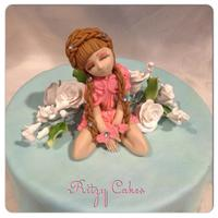 Hand-Crafted Doll Cake Hand-molded and hand-painted doll cake by Leiticia Pestova at Ritzy Cakes