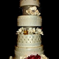 8-Tier Gold And Red Wedding Cake 8-tier gold and red wedding cake with sugar flowers by Leiticia Rice