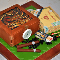 Cake For Cigar Lovers A humidor is a big cake.Box of cigars is a small cake.