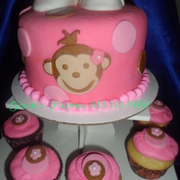 Edited With Lunapic Httplunapiccom Monkey And Baby Shoes Baby Shower Cake With Matching Cupcakes Edited with LunaPic: http://lunapic.com/ Monkey and baby shoes ...baby shower cake with matching cupcakes