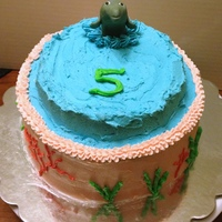 Dolphin Cake Fondant dolphin with seaweed and coral piped onto it