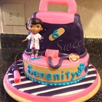 Our 2Nd Doc Mcstuffins Cake Replicated By Popular Demand Doll Is A Toy Not Edible Our 2nd Doc McStuffins cake. Replicated by popular demand. Doll is a toy, not edible.