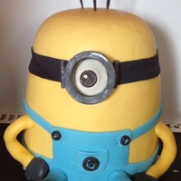 Minion Birthday Cake I did the dome head as rice crispy then attached it to the 6 cake layers and covered the join with the black fondant goggle strap. The...